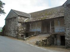 17th or 18th C. Townend Barn, Troutbeck, UK. It is a bank barn with a raised entry to the threshing floor. Animals would be on one side, grain and hay on the other, with manure shoveled into the basement until ready to be spread on fields.