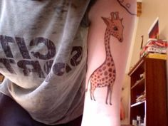 cute little giraffe tattoo! :)) -This is for you ammers! (a little smaller, maybe)