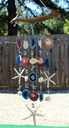 47 Beautiful Beaded Wind Chime to Add Sparkle to The Garden - GODIYGO.COM - Beautiful beaded wind chime to add sparkle to the garden 43 Informations About 47 Beautiful Beaded W - Seashell Wind Chimes, Crystal Wind Chimes, Diy Wind Chimes, Diy Home Crafts, Garden Crafts, Garden Art, Garden Whimsy, Garden Projects, Garden Ideas