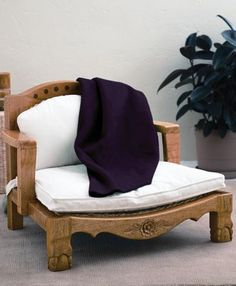 Gaiam Raja meditation chair, made from sustainable mango wood. gaiam.com