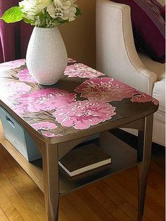 I love a hand painted coffee table and this one hits the nail on the head. Especially because it takes a nondescript table and makes it into something wonderful with very little effort.You could decoupage large color copied flowers, too. Just put sticker paper in the copy machine, cut, stick, and add MinxwaxPolycrylic to finish it off.