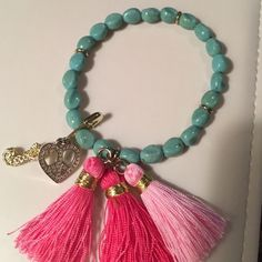 Authentic Juicy Couture Bracelet. Cute, stretchy slip on style bracelet. Removable charms. Juicy Couture Jewelry Bracelets