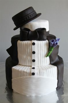 He said he wanted a top hat lol no but i can get him a cake with one! what ya think? any ideas for a grooms cake?