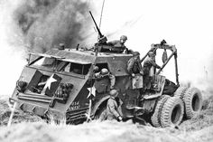 A truck M25 Sherman tries to recover a damaged, under German artillery fire in the summer of 1944 at Normandy.