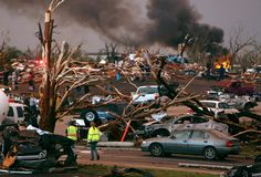 Emergency personnel walk through a neighborhood severely damaged by a tornado near the Joplin Regional Medical Center in Joplin, Mo., Sunday, May 22, 2011. A large tornado moved through much of the city, damaging a hospital and hundreds of homes and businesses. (AP Photo/Mark Schiefelbein)