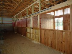 DIY Stalls. Check out the sliding stall doors.