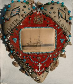 Sailor's Beaded Heart: Hearts stuffed with sawdust or sand and decorated with woven ribbons, pins, photos were specially made for soldiers and sailors for giving as gifts.