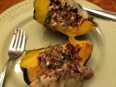 """Stuffed Acorn Squash by Coleen Hayden  This week's recipe fits into our healthy but-oh-so-yummy! category since it is full of lucious veggies, uses low-fat ground chicken, and almost no added fat.  Also, this could easily become a vegetarian meal by leaving out the meat.  Also, you will have some leftover stuffing so you could enjoy it in a different """"container"""" i.e., portabello caps, or zucchini; thus getting two meals for your effort!  Enjoy!"""