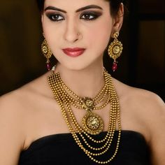 Gold plated polki necklace is a trendy necklace which is embellished with diamonds, pearls and colored polkies in the center piece which is attached with the gold patterned number of string which makes you center of attraction of everybody's eyes. #BridalJewelryCollection