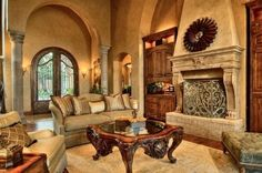 Tuscan Living Room ...Love the coffee table, front doors, and archways with pillars!