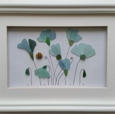 Sea glass cornflowers set inside a 35cm x 35cm glazed box frame