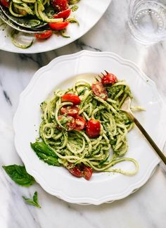 Fresh zucchini noodles tossed with basil pesto and cherry tomatoes make a light, healthy meal. Make this recipe for lunch or dinner, or serve it as a side!