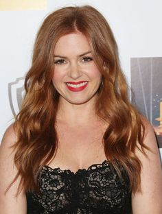 This comedienne has naturally dark auburn locks, and we've yet to see her hair look lackluster. Her shiny, tousled waves bring out the chestnut tones in her red hair, adding complexity to the color without any need for artificial lowlights.                   Source: Getty / Frederick M. Brown
