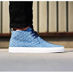 "Axel Arigato blue ""fish"" embossed suede Chukka sneaker with a back tab and three-eye lace closure. Inside, a calf leather lining and cushioned footbed deliver comfort to every wearing. #axelarigato"