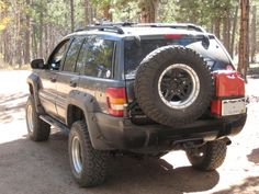 Custom rear tire carrier with fuel can storage.