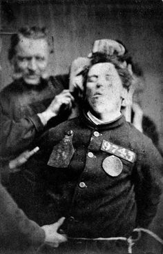 Is he pulling her hair?  Oh..poor woman..so sad. What must she have experienced to hurt her enough to bring on this? What a scary time in history to have a mental illness. I wonder what became of her...An insane asylum patient restrained by warders, Yorkshire, 1869, Henry Clarke.
