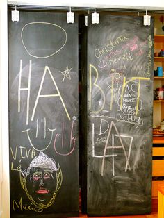Kitchen Pantry chalk board doors made with simple farm supply door hardware.