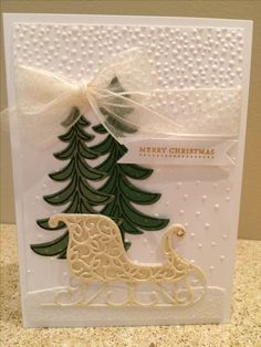 Christmas card made using Stampin' Up Softly Falling embossing folder, Santa's Sleigh stamp set with Santa's Sleigh Framelits.