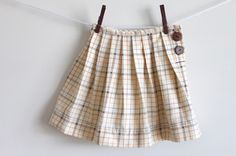 "Super cute ""back to school"" skirt. Would look so great with a pair of brown boots."
