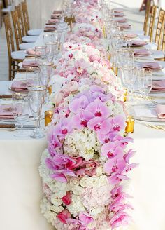 2. Floral runner: Vases filled with flowers lining a table is good- an entire runner made out of lush blooms? Now that's next level. Check out more fabulous fresh floral decor ideas. #floraltablerunner #centerpiece