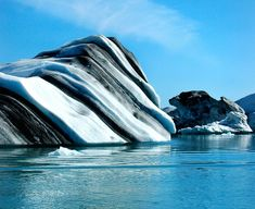 Iceberg in Jökulsárlón.  Striped iceberg photos are making their way around Pinterest.  The photos were taken by Norwegian sailor Oyvind Tangen, from aboard a research vessel, several hundred miles north of the Antarctic. Blue stripes are formed as iceberg layers melt and refreeze quickly, while green stripes are created by the freezing of algae-rich sea water. Other colored stripes, such as black, brown, and yellow, are formed by minerals.