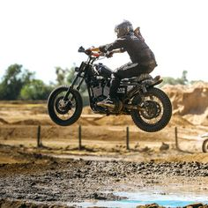 Jumping mud pits for #TrackerTuesday on that Sporty. #MakeSportstersGreatAgain | #RustyButcher | 📸 @jonathangriffith