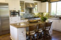 kitchen island with chairs.