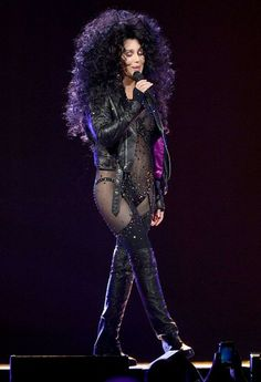 Cher was putting on a formidible exhibition of costume changes during her Dressed to Kill tour. Here, she wears an outfit similar to the one she wore back in 1988 when she took the Best Supporting Actress Oscar.