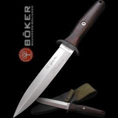 Boker Applegate-Fairbairn knife with grenadil wood scales.  Some classy stabbing right there.