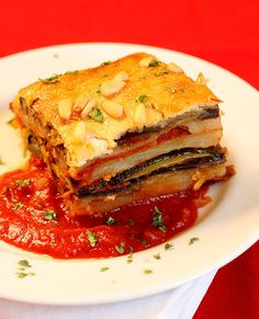 Eggplant Moussaka- coat in breadcrumbs and Layer it in a square pan. But spread Tomato marinara sauce. Top it with mashed potatoes. Mix the potatoes with olive oil. Top that with Paprika and oil. Bake uncovered.