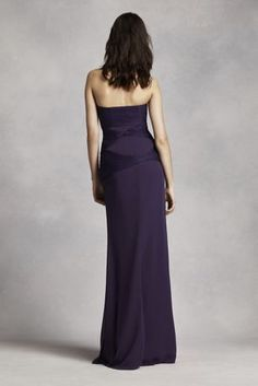 Long and luxurious bridesmaid dress with beautifully draped bodice and soft flowing sash.   Strapless column gown features asymmetrical draped bobbin net bodice and flowing sash.  Available in seleect stores and online.  Sizes 16-26 are available in stores only.  Fully lined. Side zip.Imported. Dry clean only.  Sizes and colors are available in limited stores and with limited availability.