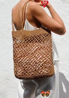 Raffia Net Bag, Crochet Raffia Tote, Summer Tote Bag, Straw Mesh Bag, Handcrafted Tote, Net Shoulder Bag — The Raffia Net Bag Crochet raffia net bag. This summer tote bag is handcrafted with care and is available in 2 colors, Tan and Black. YARN: 100% viscose raffia. COLOR: Here shown in Tan. Also available in Black. SIZE: One size. The bag approximately measures 58cm (22.8) in height and 35cm (14) in width when<br> Trendy Mood, Bag Crochet, Filet Crochet, Summer Tote Bags, Bag Women, Net Bag, Modern Crochet, Macrame Bag, Market Bag