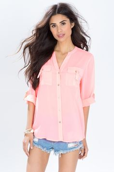 A simple everyday blouse, featuring double chest pockets with roller buckle closures. Stand-up collar. Full front button closure. Long sleeves with button tabs. Finished hem. Looks amazing with distressed denim and booties. $24.50