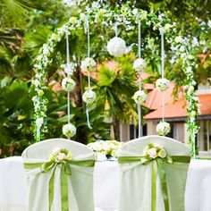 Rent our specially designed wedding arch decorated with white silk flowers with kissing balls. It serves as a romantic wedding backdrop for the solemnization venue as well as the stage decor for all wedding venues. It can be used as the wedding aisle march through as well.
