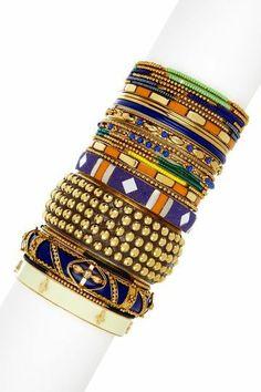 arm full of bangle bracelets