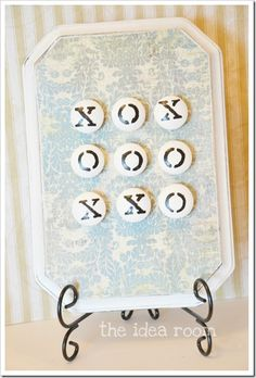 Want a really easy gift game idea for your kids friends or for your neighbors this Holiday season? How about this simple but fun Tic Tac Toe game? This portable, magnetic game is perfect for taking on road trips, restaurants or appointments to help pass the time for your restless little ones…or let's face it…yourself.  Want to know how I made it so you can make one to?  I thought so…