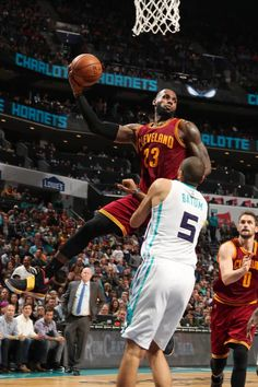 LeBron James #23 of the Cleveland Cavaliers looks to pass the ball during a game against the Charlotte Hornets on March 24, 2017 at the Spectrum Center in Charlotte, North Carolina.