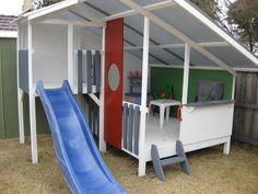Mid century mod kids playhouse outdoor fort w slide. Great for backyard. #outdoorplayhouseideas #backyardplayhouse #diyplayhouse
