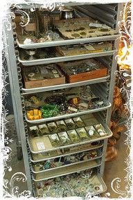 Rolling restaurant rack used as sale drawers.  No artist attribution.