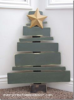 planked rustic Christmas tree be good as am advent calender just add numbers an a diff ornament to put on for each day!