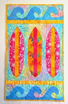 Sea Quilts: ~ Surfboards X Nine ~Surfboard and waves quilt + DIY + Inspiration + bright + tropical decor + coastal living so many awesome quilt ideas at the site..all beach related!!!  LOVE them all..great inspiration for the beach bungalow + cottage decor + patterns available.