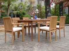 """New 7 Pc Luxurious Grade-A Teak Dining Set - 71"""" Rectangle Table And 6 Stacking Arm Chairs[ Model: LU5] by WholesaleTeak. $1325.99. Rectangle Table has 2"""" umbrella hole in the center. Table Dimension: 71"""" L, 36"""" W , 30"""" H. Picture shown with more chairs, you will receive only 6 chairs. Stackable chairs for easy storage.. ADD SUNBRELLA FABRIC CUSHIONS BY SEARCHING """"Wholesaleteak Dining Cushion"""" ON AMAZON, CUSTOM MADE FOR THESE STYLE CHAIRS. Teak wood is an extremely dense c..."""