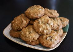 1/2 cup unsalted butter (1 stick), softened 2/3 cup packed dark-brown sugar 1/4 cup granulated sugar 1 teaspoon pure vanilla extract 2 large eggs 1 1/4 cups all-purpose flour, sifted 1/2 teaspoon coarse salt 1/2 teaspoon baking soda 1 cup semisweet chocolate chips 1 cup raisins 1 cup pecans, coarsely chopped Martha Stewart's recipe