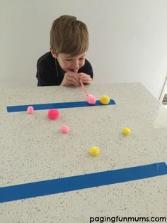 pom pom minute to win it game: see how many pom poms you can blow across the line in 1 min!