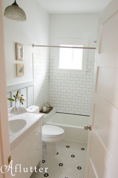 Lovely craftsman bath remodel; hex tile, subway tile, board and batten. Inspiring DIY project!