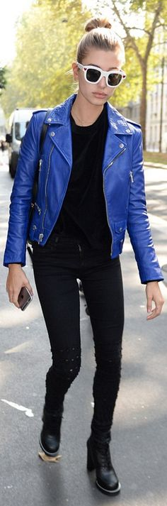 Who made Hailey Baldwin's blue leather jacket, skinny black jeans, and white heart sunglasses?
