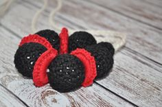 A great baby shower gift!!! #crochetbeadnecklace #teeethingnecklace #nursingnecklace #teething #ecofriendlybaby #ecofriendlybabytoy #teethingring #blackandredbaby