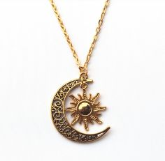 We love this beautiful and intricate gold sun and crescent moon necklace, and we…