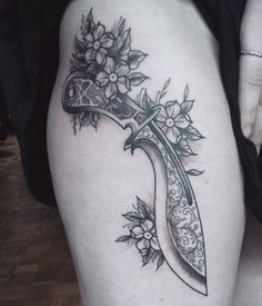 Knife thigh tattoo by Krofty at The Tattooed Arms, Lincoln, UK. Dagger. Machete. Blossom. Blackwork. Traditional. Neotraditional. Thigh.