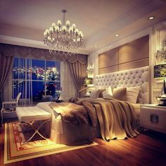 I would die for this master bedroom with a city view. Love the idea of a chandelier.
